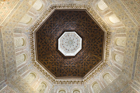 university of granada: View of the spectacular ceiling and walls of the Madraza of Granada, Spain