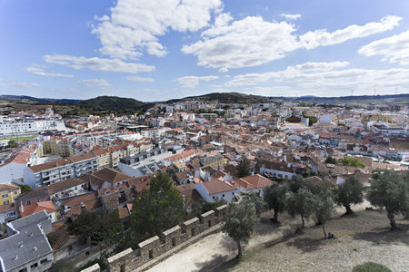 The town of Torres Vedras, Portugal, seen from inside the battlement of the medieval castle.