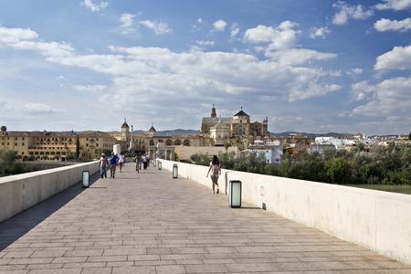 augusta: Using the ancient Via Augusta on the Roman Bridge across the Guadalquivir river in Cordoba, Spain Editorial