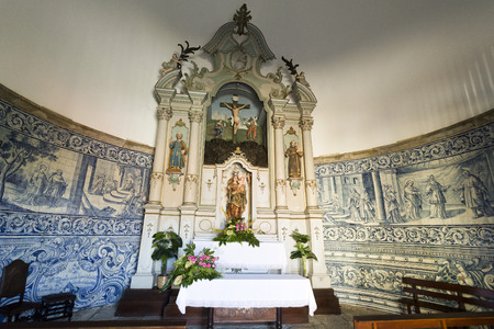 reredos: View of the chapel rococo style altarpiece with a statue of Our Lady holding the Child Jesus In Vila do Conde, Portugal Editorial