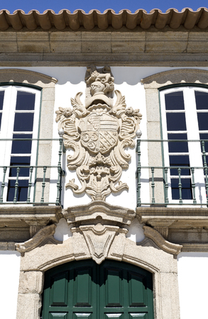 conde: Coat of arms on top of the entrance of the Manor of the Vasconcelos, in Vila do Conde, Portugal