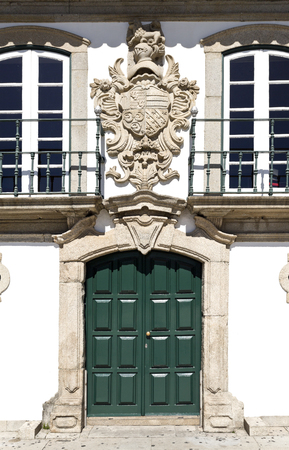 conde: Facade of the Manor of the Vasconcelos with the coat of arms on top of the door, in Vila do Conde, Portugal Editorial