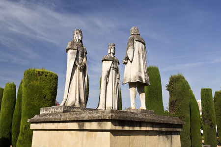 ferdinand: Statues of the Catholic Monarchs (Ferdinand and Isabella) and Christopher Columbus in the gardens of the Alcazar de Cordoba, Spain