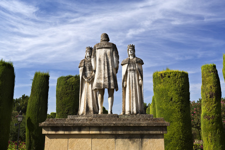 queen isabella: Statues of the Catholic Monarchs (Ferdinand and Isabella) and Christopher Columbus in the gardens of the Alcazar de Cordoba, Spain