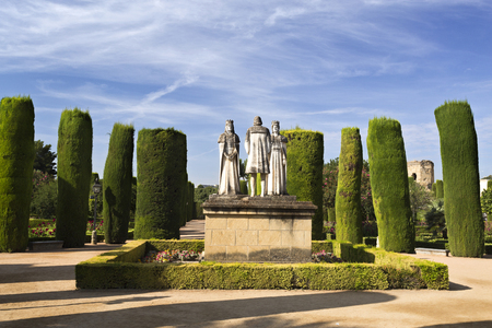 christopher: Statues of the Catholic Monarchs (Ferdinand and Isabella) and Christopher Columbus in the gardens of the Alcazar de Cordoba, Spain