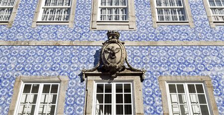 decorative balcony: Detail of a coat of arms placed above the central window on the decorative facade of a main building in Braga, Portugal