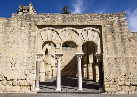 caliphate: Detail of the entrance to the Upper Basilica Hall at Medina Azahara medieval palace-city near Cordoba, Spain Editorial