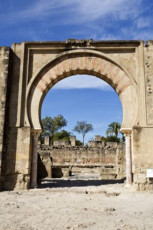 caliphate: Detail of the main arch entrance of the Great Portico at Medina Azahara medieval palace-city near Cordoba, Spain Editorial