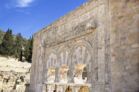 caliphate: Detail of the facade of the House of Yafar at Medina Azahara medieval palace-city near Cordoba, Spain Editorial