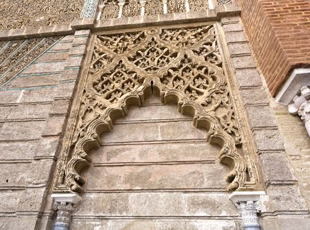 castile: Detail of the mudejar facade of the King Peter of Castile in the Alcazar Royal of Seville, Spain Editorial