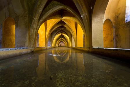 padilla: View of the Baths of Lady Maria de Padilla, rainwater tanks beneath the Patio del Crucero, in the Alcazar of Seville, Spain Editorial