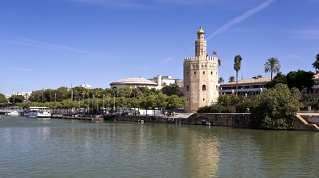 The Torre del Oro (Tower of the Gold), a dodecagonal military watchtower, seen from the Guadalquivir River in Seville, Spain.
