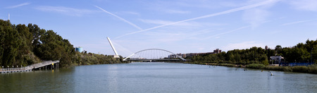 spar: View of the Guadalquivir River with the spar cable-stayed of the Alamillo bridge behind the Barqueta Bridge in Seville, Spain