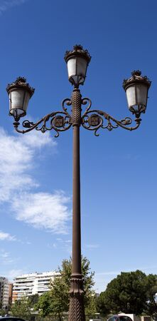 Lamppost of ancient style along many of the old streets of Seville, Spain
