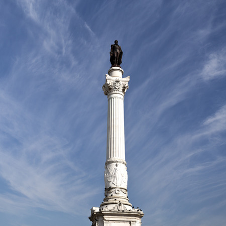 Detail of the bronze statue of King Pedro IV on top of a 23m high Corinthian order column in Lisbon, Portugal