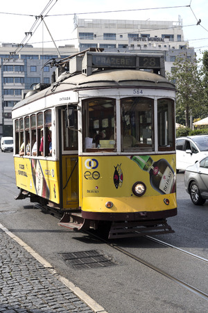 baixa: Old style tram operating on the famous route 28 in Lisbon, Portugal