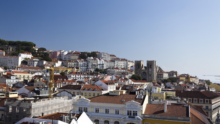 baixa: Cityscape from the lookout on top of the Augusta Street Arch towards the Alfama district in Lisbon Portugal. Features the old Cathedral.