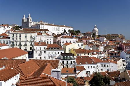 baixa: Cityscape from the lookout on top of the Alfama (Miradouro das Portas do Sol) towards the Monastery of Sao Vicente de Fora in Lisbon Portugal. Stock Photo