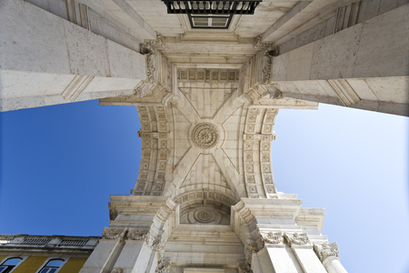 augusta: Upwards view of the Rua Augusta Arch, a stone triumphal arch-like historical building and main attraction on the Praca do Comercio in Lisbon, Portugal