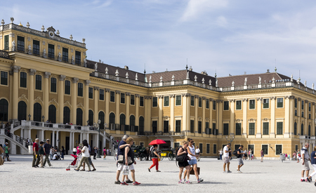 the former: Tourists and the baroque Schonbrunn Palace, a former imperial summer residence located in Vienna, Austria.