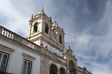 imposing: The imposing Church of Our Lady of Nazare (Igreja de Nossa Senhora da Nazare) located on the hilltop O Sitio overlooking Nazare, Portugal Stock Photo