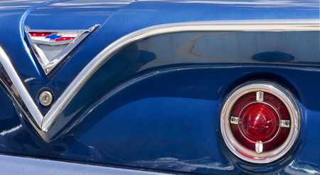 Detail of the rear section of a 1961 Chevy Bel Air car including the rear lights and Chevrolet badge, in Brisbane, Australia Editorial