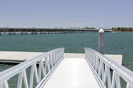 View of a new recreational pier and floating dock at the Pumicestone Passage near the bridge to the Bribie Island, Queensland, Australia