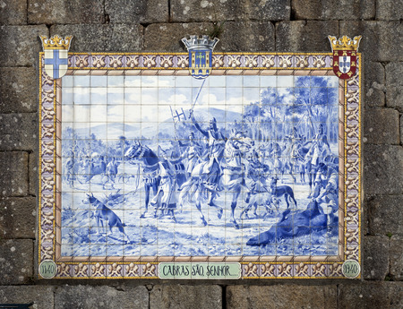 Panel of blue ceramic tiles depicting Portuguese King Afonso Henriques during a hunting scene in 1140. Editorial