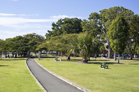 People enjoying the warm weather of a winter Sunday in New Farm Park, Brisbane, Australia