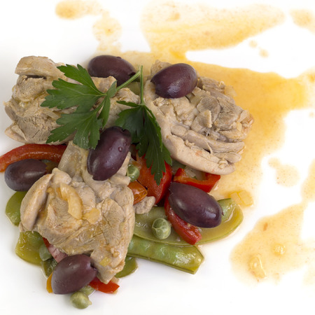 Snow pea (Pisum sativum) and chicken stew with olives Portuguese style