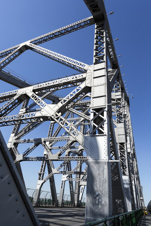 Story Bridge, a steel truss cantilever bridge spanning the Brisbane River and carrying vehicular, bicycle and pedestrian traffic in Brisbane Australia.