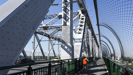 Story Bridge, a steel truss cantilever bridge spanning the Brisbane River and carrying vehicular, bicycle and pedestrian traffic in Brisbane, Australia. Stock Photo