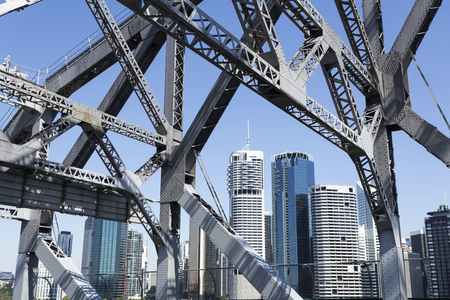 The cityscape seen through the steel trusses of the Story Bridge in Brisbane, Australia Editorial