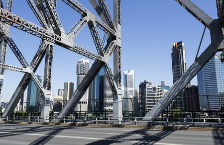 The cityscape seen through the steel trusses of the Story Bridge in Brisbane, Australia Stock Photo