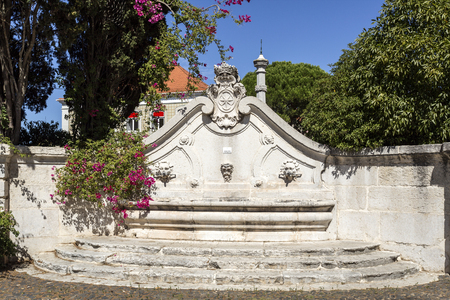 View of the eighteenth century fountain with three spouts and the coat of arms of the Marquis of Pombal, in Oeiras, Portugal