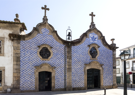 Peculiar facade of two bodies entirely covered with ttaditional Portuguese tiles of the Church of Mercy, in Braganca, Portugal