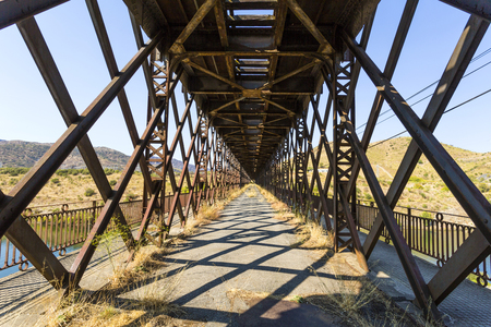 The abandoned road inside the truss bridge crossing the Douro River in Pocinho, Douro region, Portugal