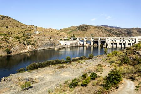 View of the Pocinho Dam on the Douro River near the village of Pocinho, Douro Region, Portugal