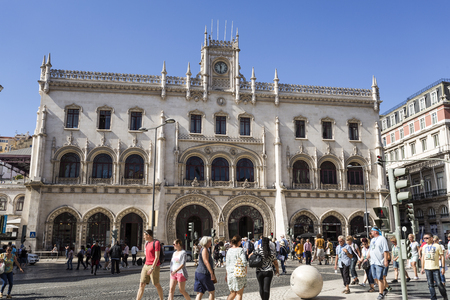 People in front of the Neo-Manueline style facade of Rossio railway station in the historice centre of Lisbon, Portugal Editorial