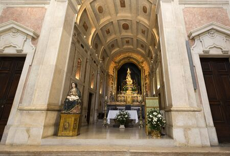 The high altar with vaulted ceiling, gilded retable and altar with the image of Our Lady of the Conception. Stock Photo