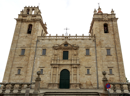 Catholic cathedral of mannerist style with an austere facade flanked by imposed bell towers on each side and surmounted by rail, in Miranda do Douro, Portugal Stock fotó