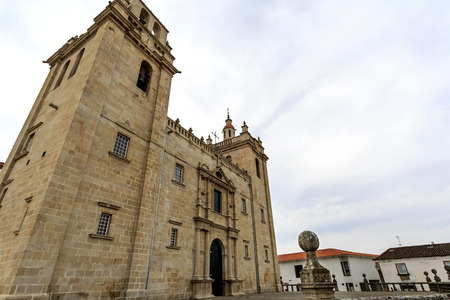 Catholic cathedral of mannerist style with an austere facade flanked by imposed bell towers on each side and surmounted by rail, in Miranda do Douro, Portugal Stock Photo