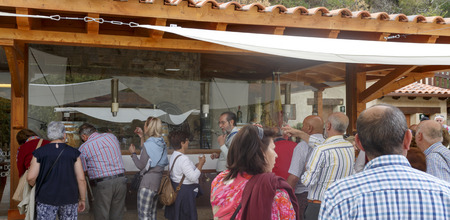 Tourists tasting the region Port Wine at the end of the river cruising on the Douro International Nature Park, in Miranda do Douro, Portugal Editöryel