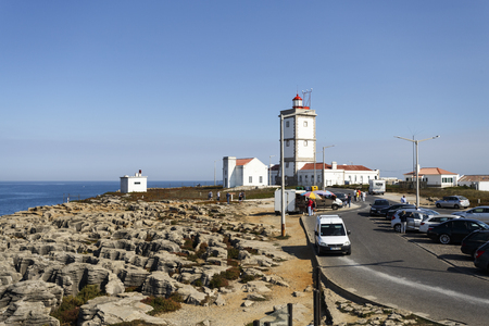 Lighthouse of Cape Carvoeiro which is located on the far western corner of the Peniche peninsula in Portugal Reklamní fotografie