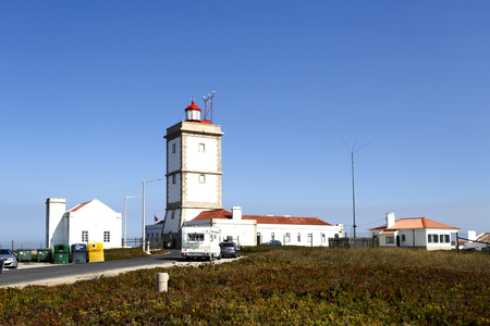 Lighthouse of Cape Carvoeiro which is located on the far western corner of the Peniche peninsula in Portugal Banco de Imagens