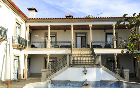 Classic house with verandah, granite staircase and water feature in the garden terrace, in Amarante, Portugal