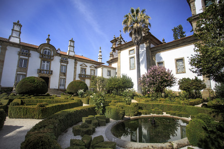 View of the tailored boxwood hedges of the Mateus Palace gardens, in Vila Real, Portugal
