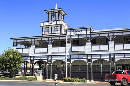 The iconic Victoria Hotel is a brick and timber building with a criss-cross of dark panelling and white lattice, stained glass windows and an ornamental tower, in Goondiwindi, Queensland, Australia Stock Photo