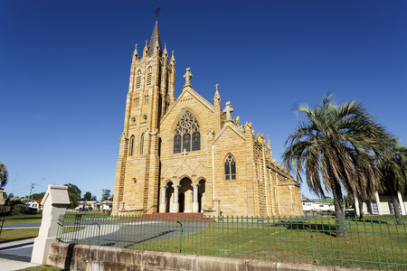 St Mary Catholic Church is a twentieth century Gothic revival sandstone church erected between 1920 and 26, with a traditional cruciform plan. Stock Photo