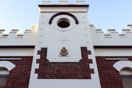 Detail of the red brick building and logo of the Salvation Army family store in Parkes, NSW, Australia 写真素材